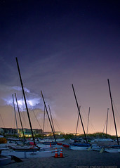 Lightning Storm Passes Over Ocean City (mhoffman1) Tags: storm beach weather night boats evening newjersey unitedstates nj stormy coastal bolt mast lightning oceancity masts atlanticocean starry beachfront lightningbolt hobie catamarans eastcoast a77