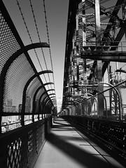 High Noon [Explore, Sep 11, 2014 #88] (Mariasme) Tags: bridge blackandwhite monochrome lines vanishingpoint industrial shadows second iphone leadinglines matchpointwinner flickrchallengegroup flickrchallengewinner 15challengeswinner agcgwinner mpt399