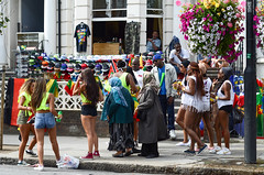 Notting Hill Carnival 2014 (Marta_or) Tags: men london window festival stand women colours different candid flag sunday streetphotography diversity parade cap caribbean nottinghill nottinghillcarnival streetparty sellers 2014 vuvuzela mixofcultures perksoflivinginlondon