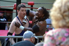 I put him in a power lock and apply pressure, presto! (kennethkonica) Tags: blue costumes red shirtless people usa white men america fun nikon women midwest faces wrestling indianapolis bodylanguage indy indiana contact fighting wrestlers fights nikond7100