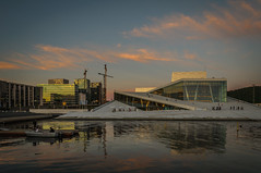 Oslo Opera House (cwaersten) Tags: oslooperahouse opera oslo sunset water skyline hills cloud sky fjord pink orange blue crane construction high boat refelction sun summer evening scenic people outdoor architecture structure building buildings waterfront cityscape nikon d90