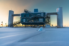 The Ice Cube and the IceCube Lab (redfurwolf) Tags: southpole antarctica icecube ice cube snow icecubelab sunset light sky building architecture redfurwolf sonyalpha sony a99ii sal1635z outdoor