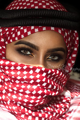 She cannot dream (DesertWindsPhotography) Tags: red white black love makeup art photography green eyes eyebrows culture tradition arabia saudi qatar bahrain kuwait emirates desert women veil عيون السعودية الكويت الإمارات الشماغ احمر