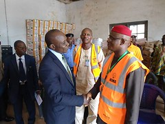 The Governor of Ebonyi State represented by the Honourable Commissioner for Border, Peace & Conflict Resolution, Hon. Donatus Aja having a handshake with the new Zonal Coordinator of NEMA South East