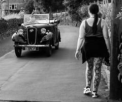 austin seven.jpg (dave 59) Tags: woman white black cars tarmac vintage walk brickwalls driver