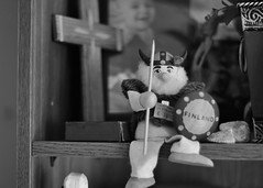 199/365: Stinkbug on a Viking doll on the souvenir shelf (Stephen Little) Tags: 50mm 50mmf17 minolta50mmf17 minoltaaf50mmf17 minolta50mm sonya77 jstephenlittlejr slta77 sonyslta77 sonyslta77v sonyalphaslta77v
