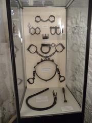 Cuff case (Nekoglyph) Tags: york white black metal chains dungeon exhibit historic prison waist whip thumb wrist handcuffs restraints flail castlemuseum girdle manacles