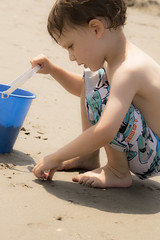 a moment to ponder. (hey there annie) Tags: boy summer portrait usa sun playing cute beach boys kids children fun seaside newjersey kid interesting sand nikon thought peace child play little candid snapshot nj happiness zen imagine jewish imagination meditation moment ponder oceancity dig preschooler 3yearold nikonusers d3200 d3200users