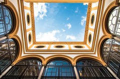 Sky in Seville (Franco Beccari) Tags: world city trip travel blue windows red vacation sky white holiday black color colour green tourism nature yellow clouds photography spain nikon europe pov courtyard seville nikkor andalusia d600