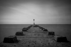 Mousetrap (Robgreen13) Tags: ocean uk longexposure shadow bw seascape beach canon eos mono coast pier long exposure waterfront shoreline coastal dorset minimalism bournemouth moorland bos