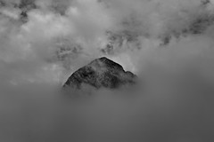 Out Of The Clouds II (Akromac) Tags: blackandwhite bw mountains clouds wolken berge schwarzweis