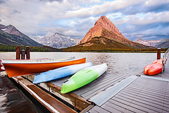 Dawn at Many Glacier Hotel (Jackpicks) Tags: lake dock montana canoes glaciernationalpark manyglacierhotel