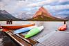 Dawn at Many Glacier Hotel (Jackpicks) Tags: lake dock montana canoes glaciernationalpark manyglacierhotel
