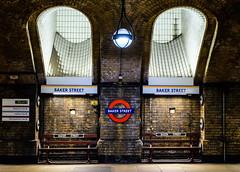 Clued Up (Douguerreotype) Tags: uk gb britain british england london city urban underground tube metro subway sign bench brick old historic