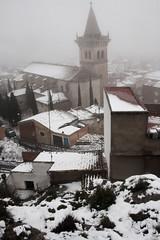 The Church's tower behind of the snowy hillside (pgarodenas) Tags: fog snow yecla tower church
