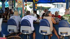 Fin and Tonic (Poocher7) Tags: isleofcaprifl islandgypsy bar waterfront pinacoladas beer barstools outdoor florida usa southwestflorida sunhat candid people portrait barscene pirategirl anchor snglasses fun conversation finandtonic swordfish blue