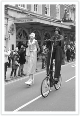 Police Escort (dhcomet) Tags: london stpatricksday parade piccadilly policeman lady stilts tall bike bicycle fortnum mason
