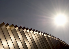 Into the Sun.  Parliament Hill Lido, London. NW5 (MJ Reilly) Tags: swimmingpool modern reflected silver metalic lido sunlight abstract sunshine nikon d7200 nikond7200 parliamenthill corporationoflondon parliamenthilllido hampstead hampsteadheathlido modernarchitecture architecture gospeloak fence wall