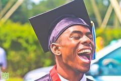 Malik. 18. Congrats. (FotosByDM) Tags: people sun blur canon moments niceshot florida smooth graduation 100mm highschool f2 congrats