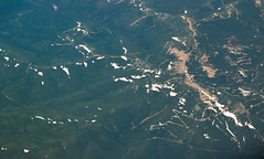 IMG_2840 (jaglazier) Tags: trees panorama snow mountains ecology june landscape landscapes russia united logging aerial siberia environment roads forests conifers khabarovsk unitedairlines 2014 aerialphotos loggingroads clearcuts coniferoustrees ua835 khabarovskkrai 61014 ordtopvg tugurochumikansky tugurochumikanskydistrict