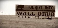 Billboard for Wall Drug in South Dakota (gravescout) Tags: wall sepia southdakota souvenirs buffalo tourist billboard drugstore bison walldrug giftshop takenfromthecar takenfromcar