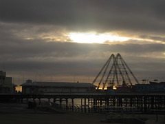 halo (Nibbler1977) Tags: lighting uk light sunset sea england cloud sun beach clouds pier seaside central over shore through setting blackpool beams breaking waveslight