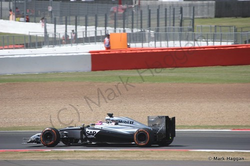 Jenson Button in his Mclaren during Free Practice 1 at the 2014 British Grand Prix