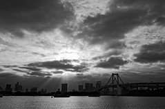 The Bay's Ray's (ShotoPhoto) Tags: bridge sky blackandwhite bw japan clouds silver boats tokyo bay fujifilm odaiba daiba decks sunrays drama rainbowbridge xt1 perfecteffects xf23mm