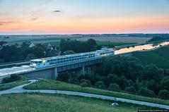 Ship crossing a bridge at Main-Donau-Canal (kucheryavchik) Tags: bridge germany deutschland franconia franken channel waterway logistics fuerth mittelfranken maindonaukanal middlefranconia
