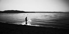 Untitled (bwaddict) Tags: light sea blackandwhite bw monochrome reflections person early candid highcontrast