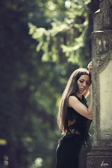 behind it all (dionn-k) Tags: black beauty cemetery longhair mysterious brunette blackdress artisticphotography fashionportraiture behinditall