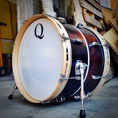 14X20 lone wolf bass drum. M/P/M with maple re-rings, black satin stained and distressed. White glass sparkle center inlay... For being so small, this drum sounds like a beast. Can't wait to hear some recordings of this! #qdrumco #mahogany #distressed #is