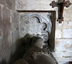 The 14th C. effigy of a knight whose feet rest on a lion under a cusped canopy set into the east wall of the chancel, the Church of St Laurence, Surfleet, Lincolnshire, England (Hunky Punk) Tags: churches medieval gothic laurence lawrence surfleet lincolnshire england monuments tombs effigies knights legs crossed legged chainmail hughdecressy roger lincs middleages spencermeans hunkypunk building listed eh englishheritage gradei grade1 church