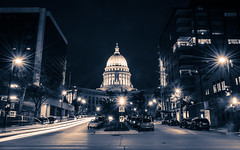 capitolizing (almostsummersky) Tags: street longexposure urban building fall cars wisconsin night dark trafficlight downtown traffic state dusk streetlights monochromatic capitol madison lane dome granite government lighttrails bluehour middle