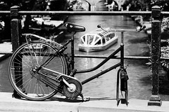 (ingehoogendoorn) Tags: blackandwhite holland bike bicycle canal utrecht zwartwit thenetherlands bikes depthoffield blacknwhite fietsen fiets gracht shallowdepthoffield rondvaartboot dutchcity dutchbike fietswrak dutchbikes