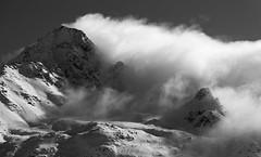 The wave hits (eichlera) Tags: italy alps europe mountains cloud sky sun snow monochrome blackandwhite