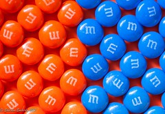 Orange and Blue - Macro Mondays (Sheldon Emberly) Tags: orangeandblue macromondays orange blue macro mandms candy naturallight graphicdesign 5050 mmcandy rows