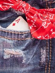 Ace in the pocket. (Vardy2010) Tags: macromondays macro theme clothtextile jeans bow red rip vintage silver ace card stitch worn hmm happymacromonday