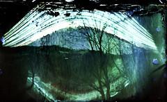 Solargraphy over Oria river (robertrutxu) Tags: pinhole paper papera ilford epson andoain river sun solarigrafía eguzkigrafia filmcanister papel longexposure oria ibaia estenopo estenopeica homemade camera
