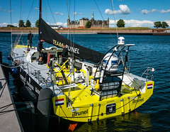 Racing (channel one) Tags: trees sea castle water yellow boat harbour digilux2 young fast racing strong determined digilux kronborg