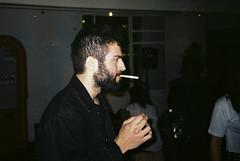Dylan smoking (oruibraga) Tags: friends party people guy film night analog beard photography superia cigarette olympus smoking bearded fujicolor superzoom 800s