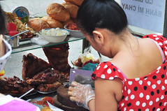 Chop, chop (Roving I) Tags: markets vietnam polkadots buns chopping rubbergloves saigon roastpork hcmc choppers hochiminh breadrolls streetvendors boiledeggs plasticgloves banhmichay