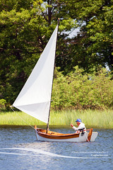 Wooden Sailboat on Lake (Craig - S) Tags: wood lake man reflection nature water sailboat outside boat wooden pond woods midwest sailing michigan craft sail daytime tiller inlandlake