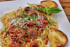 Mmm... roasted grape tomatoes on pasta (jeffreyw) Tags: pasta garlic basil oliveoil parmesan angelhair thinspaghetti roastedgrapetomatoes