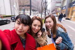 Three young women taking selfie pictures after shopping (Apricot Cafe) Tags: img617616 2029years asia asianandindianethnicities japan japaneseethnicity marunouchi sigma20mmf14dghsmart tokyojapan buildingexterior carefree casualclothing charming cheerful citylife closeup day enjoyment fashion freedom friendship happiness horizontal humanface lifestyles lookingatcamera onlywomen outdoors photography portrait selfie shopping shoppingbag smiling springtime street threepeople togetherness women youngadult