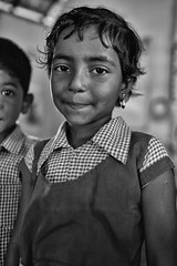 The Diplomat (alisdair jones) Tags: ef35mmf14lusm portrait child girl preschool uniform nainativu sri lanka