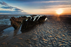SS Nornan (modulationmike) Tags: boat wreck sunset coastal reflections sans colour wood nikon lens exposure clouds blue texture