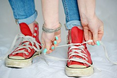 Lace It Up (Clare-White) Tags: shoes red converse legs closeup helen blue jeans allstars indoors bluejeans fingers polish chucks hands female light fashion 2 two f64g81r2win mpt538 matchpointwinner