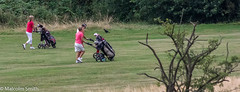 Out With Friends (M C Smith) Tags: golf girls green course trees bushes red trollies clubs bird