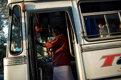 The Conductor (alisdair jones) Tags: ef35mmf14lusm bus man conductor galle srilanka